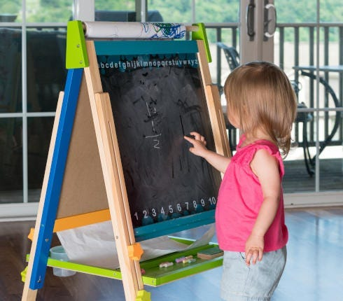 child with home made blackboard