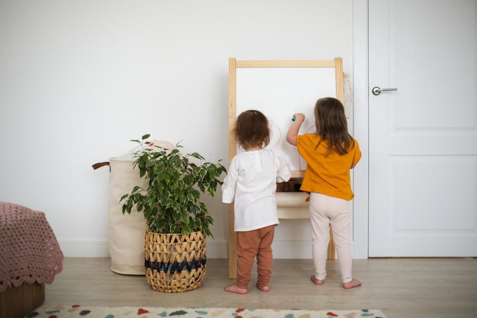 children playing with a home-made easel