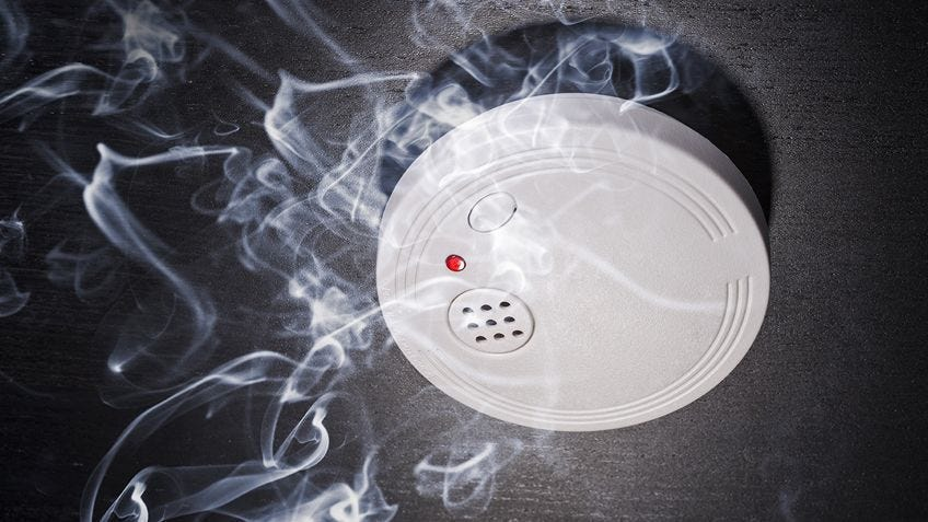 smoke rising to a smoke alarm