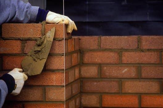 Man doing a bricklaying.
