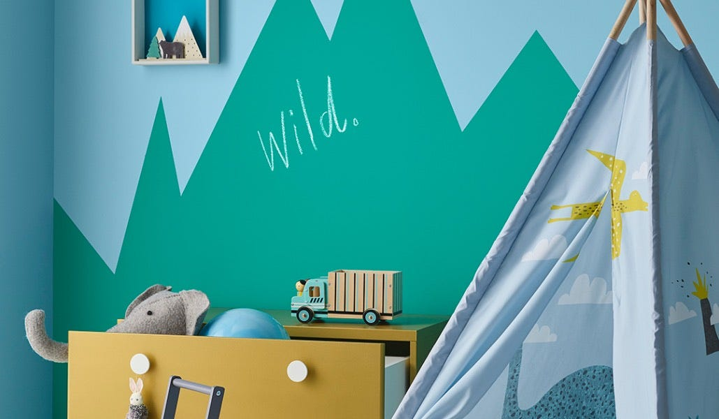 kids playroom with teepee and mountain chalkboard paint on wall
